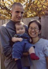 Jeremy Hinzman with his wife and child